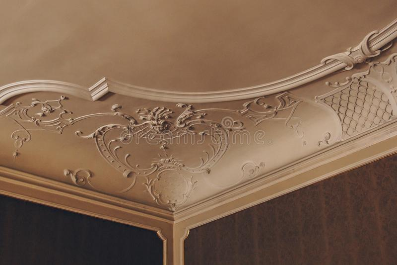 Luxury pattern stucco on the wall and ceiling. interior texture, background royalty free stock photo