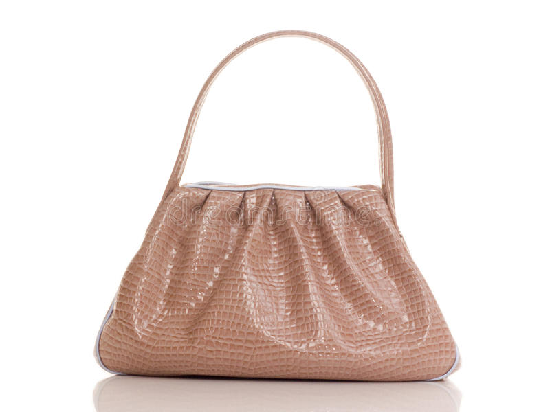 Luxury pink female bag. On white royalty free stock image