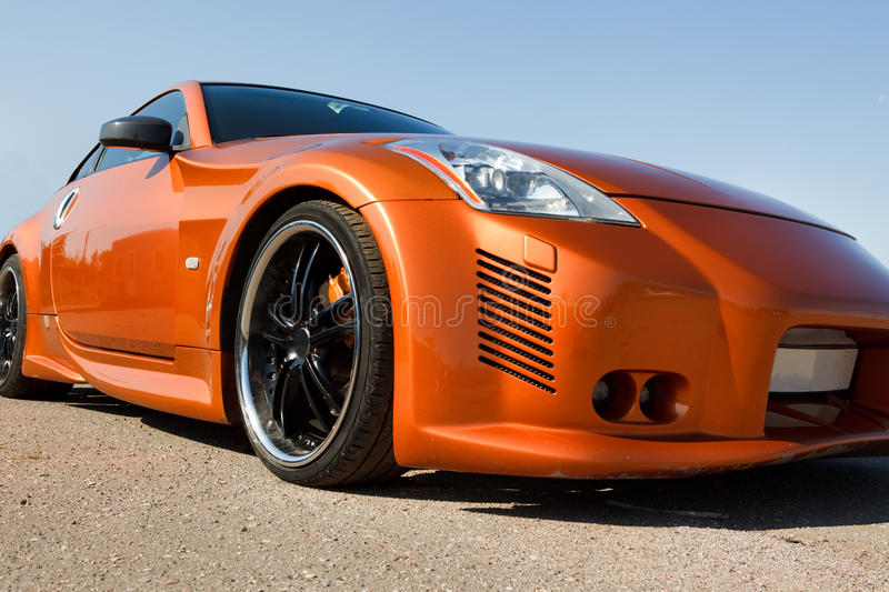 Luxury power-car. Closeup, low angle view stock images