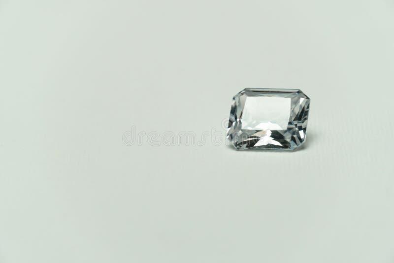 Luxury precious white gemstone for jewelry on white fashion background. Luxury precious white diamond or gemstone for jewelry on white fashion background stock photos