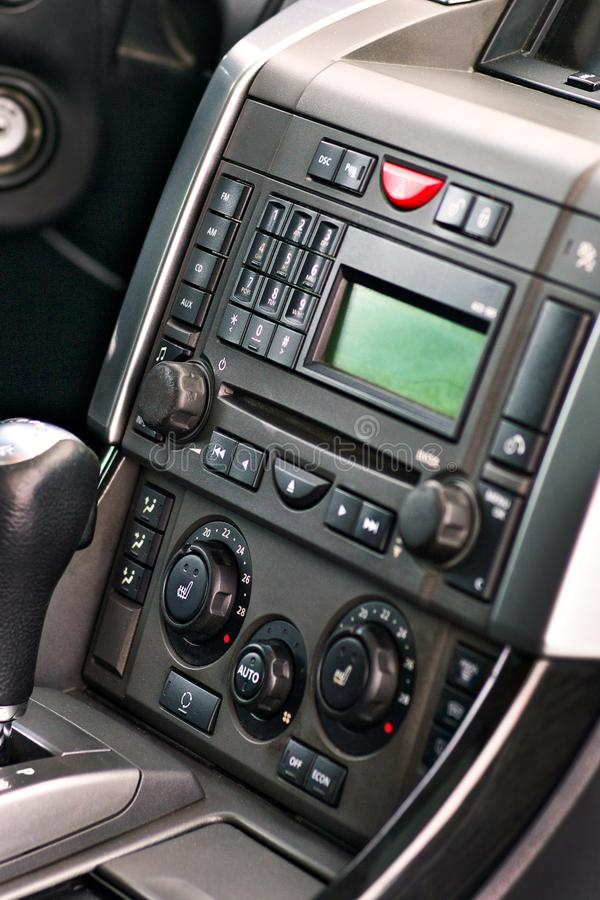 Luxury prestige car interior details. Middle console with gearbox air and multimedia controls royalty free stock images