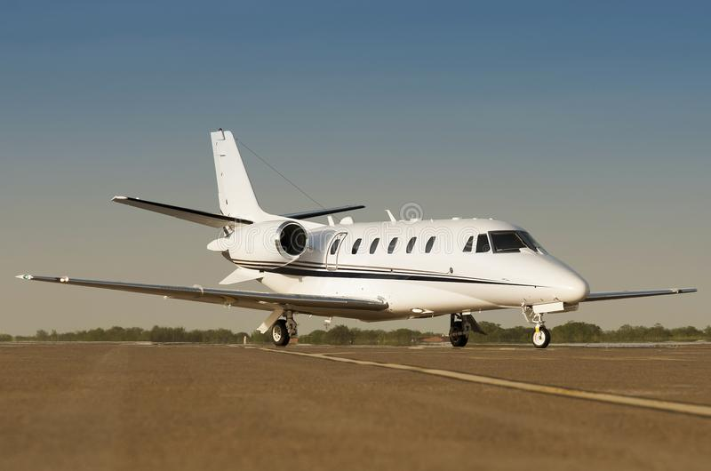 Luxury private business jet on a airport runaway stock photo