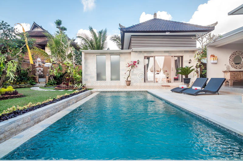 Luxury and private villa with pool outdoor stock image for Hire a swimming pool for the garden
