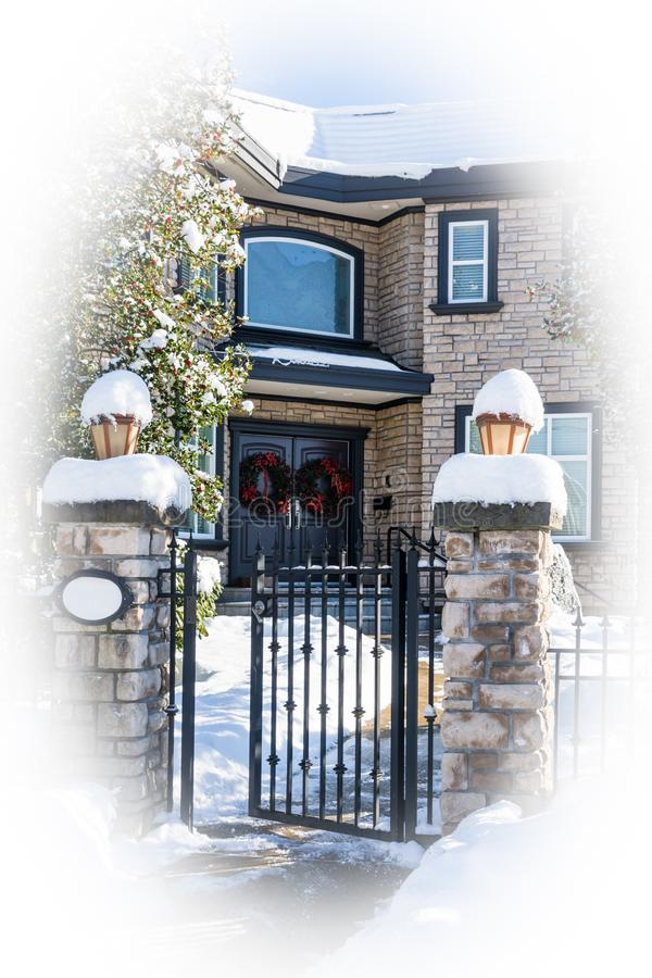 Luxury residential house entrance decorated for Christmass. White round borders. Luxury residential house entrance decorated for Christmass holiday. Family house stock photo