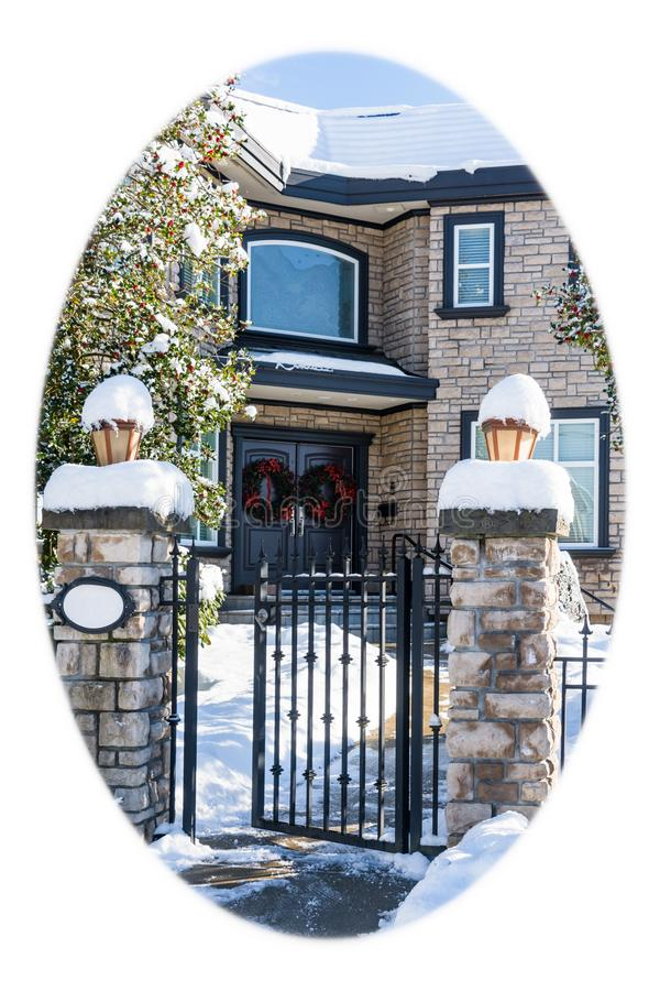 Luxury residential house entrance decorated for Christmass. White round borders. Luxury residential house entrance decorated for Christmass holiday. Family house royalty free stock image