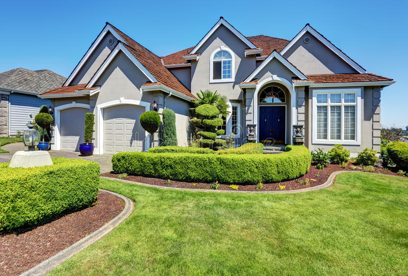 Luxury residential house with perfectly kept front garden. stock photos
