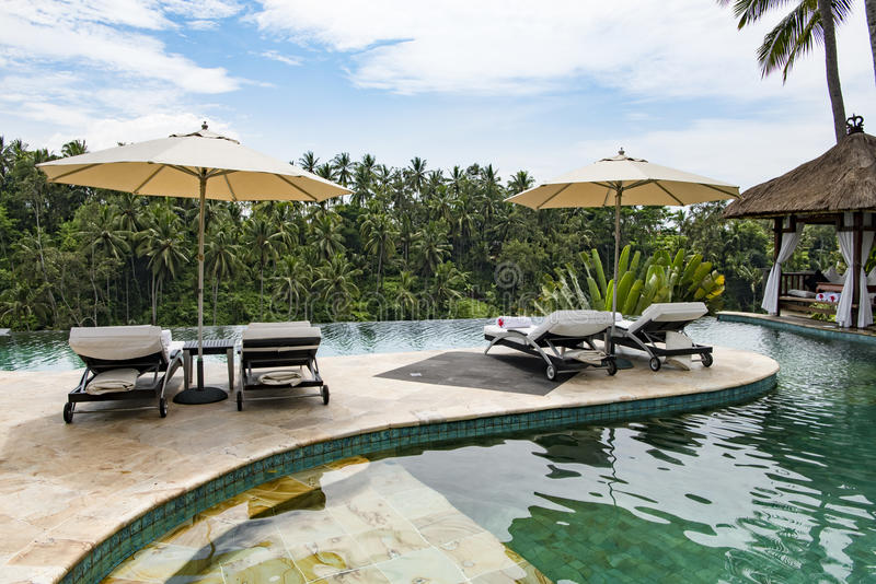 Luxury resort outdoor pool in the jungle of Bali. Outdoor pool of luxury Hotel Viceroy, Ubud, Bali. Pool at the edge of rainforest of Bali stock photos