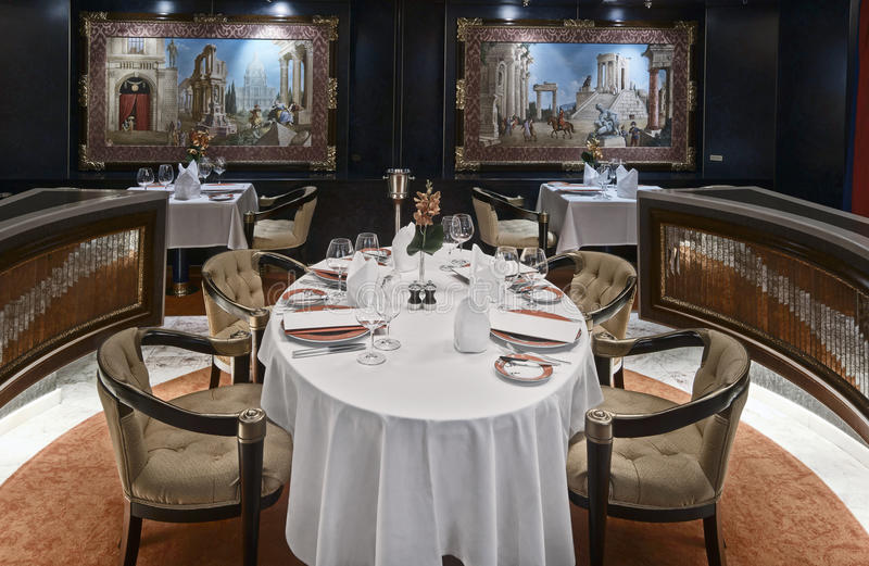 Luxury restaurant with beautiful table setting stock images