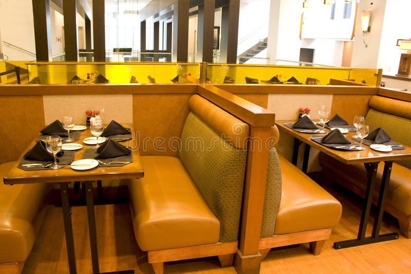 Luxury restaurant with comfortable seatings stock images