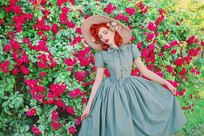Luxury retro girl with red lips in mint dress on a beautiful summer background. Stylish woman. Fashionable summer clothes. stock images