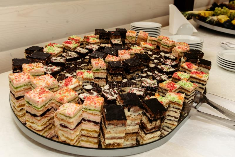 Luxury rich delicious cakes on wedding table at the reception, royalty free stock images