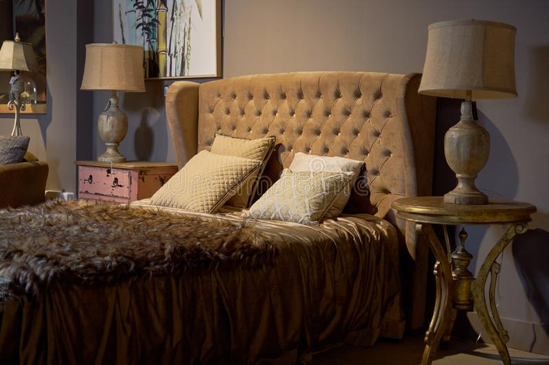 Luxury and rich hotel room. Glamorous, elegant baroque dream bedroom design interior. Brown, beige colour, nobody royalty free stock images