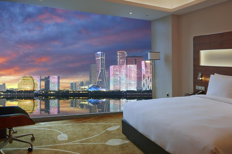 Luxury room and Hangzhou skyline through window royalty free stock images