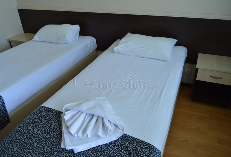 Luxury room with two beds in a modern hotel stock image