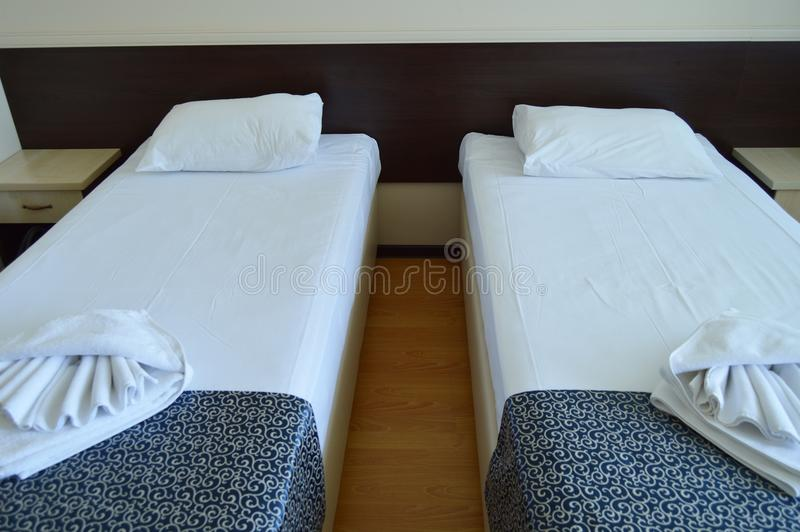 Luxury room with two beds in a modern hotel royalty free stock photography