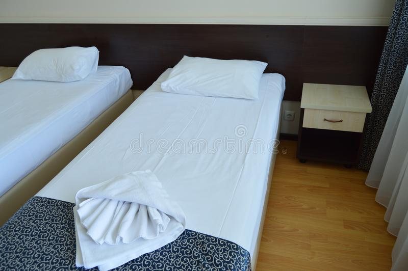 Luxury room with two beds in a modern hotel royalty free stock photo