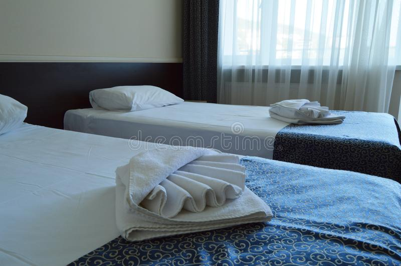 Luxury room with two beds in a modern hotel stock photos