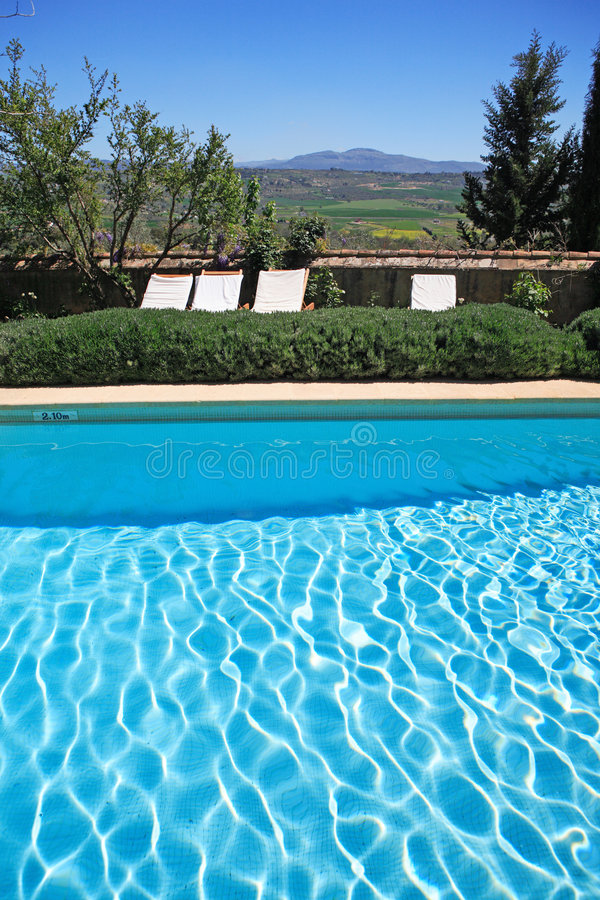 Luxury rustic hotel and swimming pool in countryside stock images