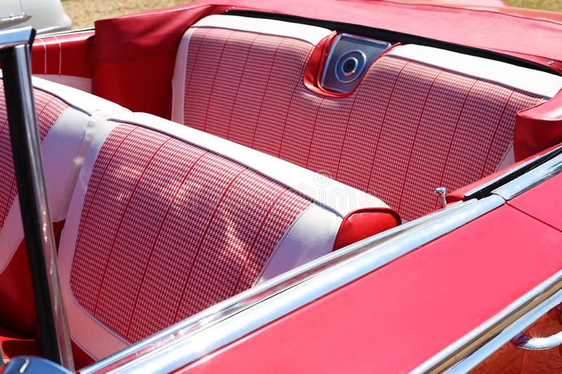 A luxury salon of a retro car in red color stock photos