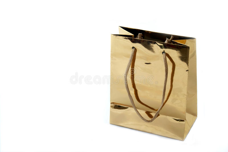 Luxury shopping bag. A luxury gold shopping bag isolated on white background stock photos