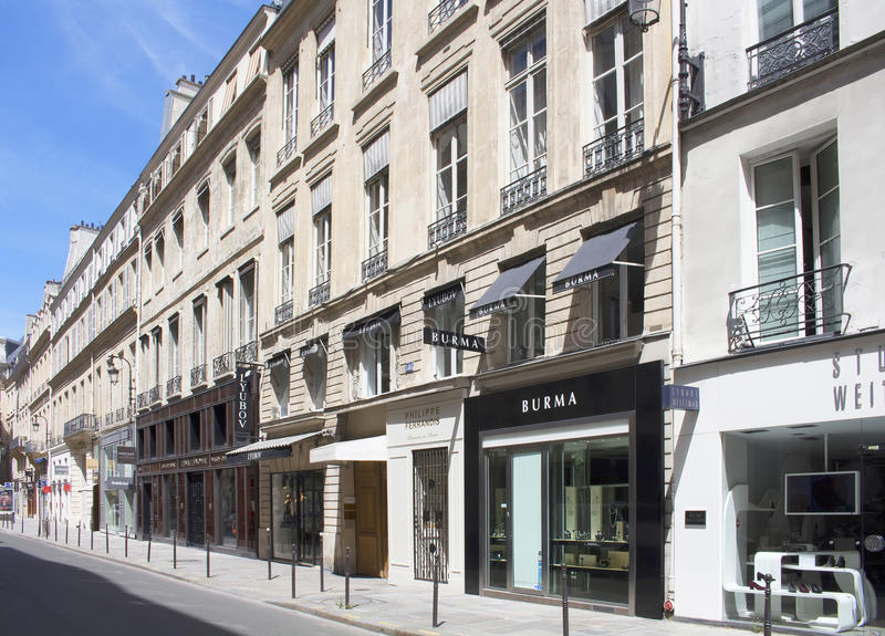 Luxury shopping street Rue Saint Honore. In Paris. Famous brands' shops are in the view royalty free stock images