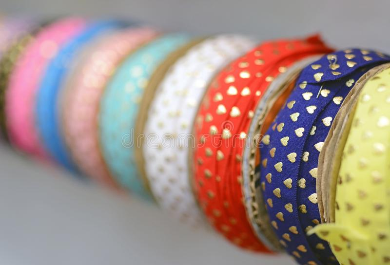 Luxury silk ribbons for sewing on cloths and garments. Handicraft royalty free stock image