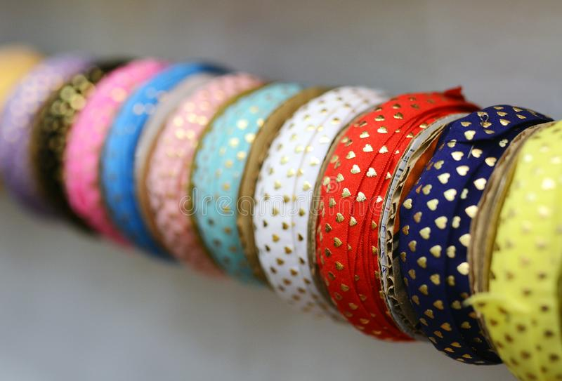 Luxury silk ribbons for sewing on cloths and garments. Handicraft royalty free stock photo