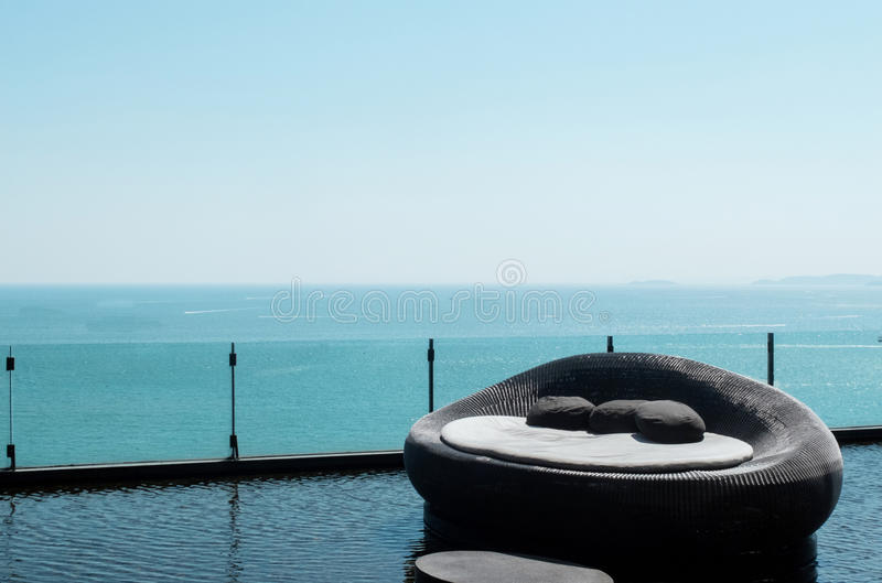 Luxury Sofa Bed at Right Corner with Tranquil Scene Beautiful Sea View in Pattaya, Thailand and Clear Sky as Copyspace. To input text stock image