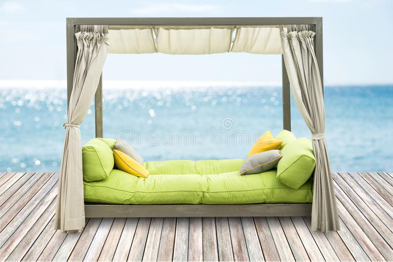 Luxury Sofa Bed with Soft Pillow as Interior. Furniture with Blue Sea royalty free stock images