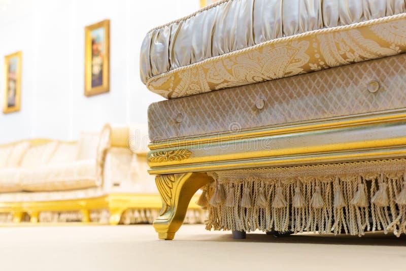 Luxury sofa in beige fashion interior. Luxury beige interior with nice big sofa closeup royalty free stock image