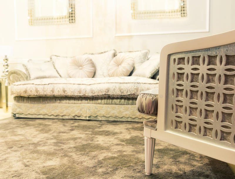 Luxury sofa in beige fashion interior. Luxury beige interior with nice white sofa stock images
