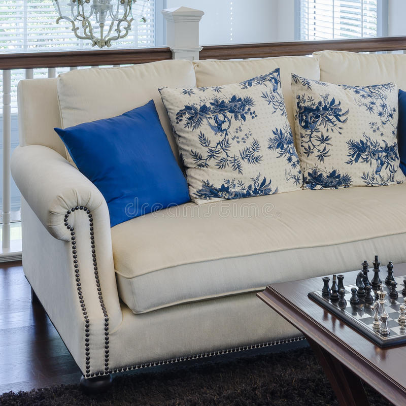 Luxury sofa with blue pillow on brown carpet in living room stock photo