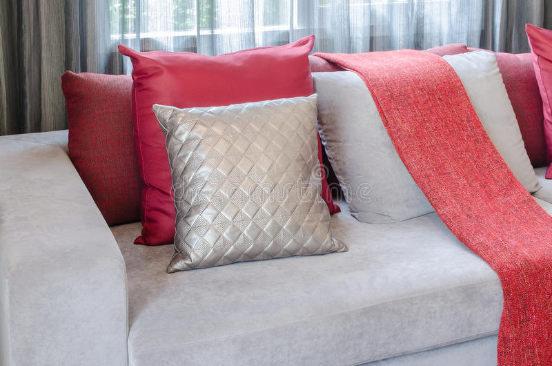 Luxury sofa with pillows and red blanket in living room royalty free stock image