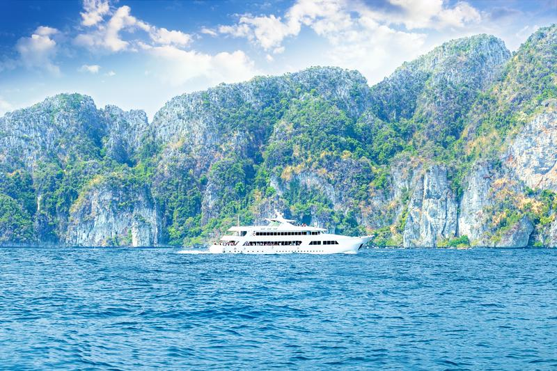 Luxury speed boat in beautiful ocean round island near Phi Phi Islands, Thailand. Travel concept. Asia stock photography