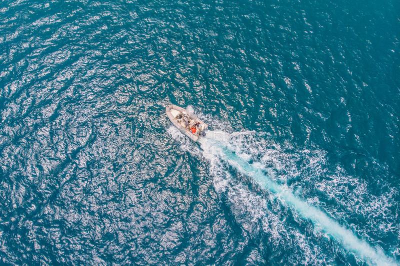Luxury speed motor boat. Clear blue turquoise water. Aerial view stock photography