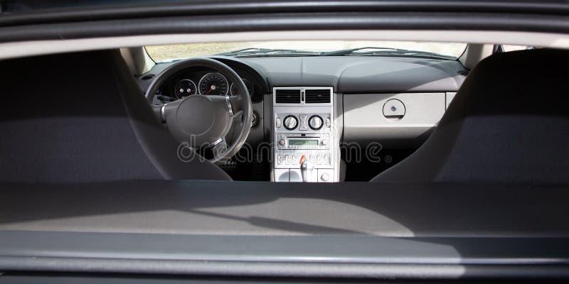 Luxury sport car Interior steering wheel, shift lever and dashboard. A Luxury sport car Interior steering wheel, shift lever and dashboard royalty free stock photo