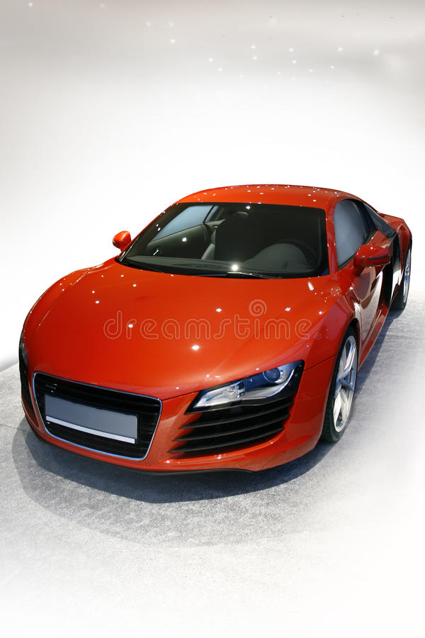 Luxury sports car. Luxury red super sports car in light showroom stock photos