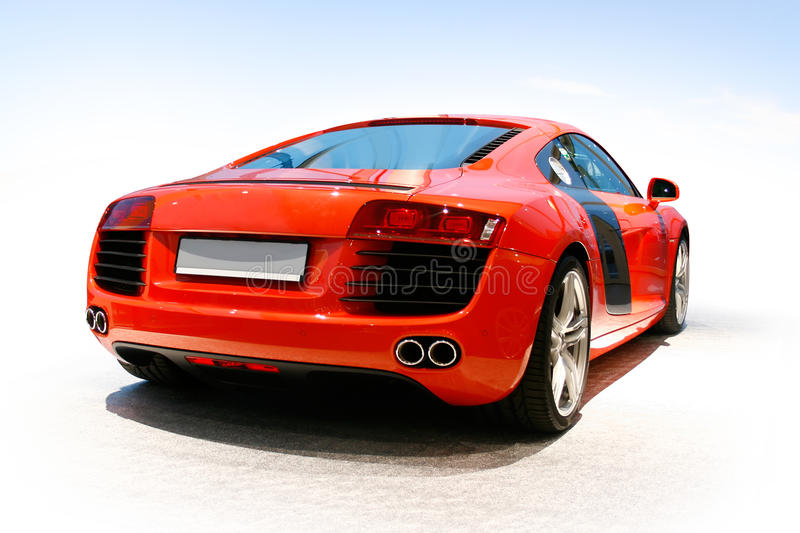 Luxury sports car. Luxury red super sports car in light showroom royalty free stock photography