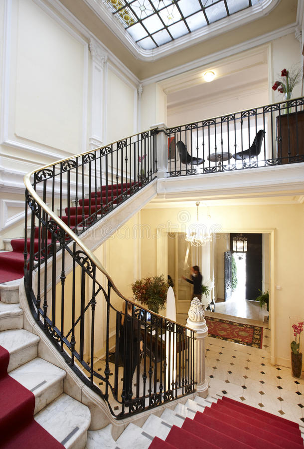 Luxury stair with red carpet in an classic residence stock for Luxury stair carpet