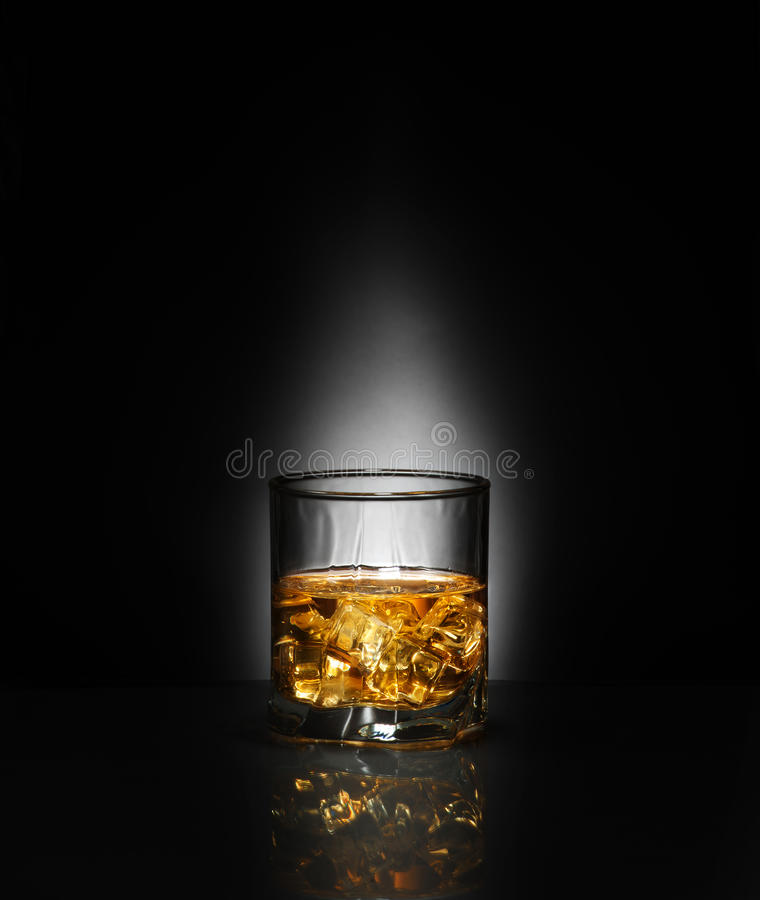 Luxury still life of whisky glass. Point backgound light. Copyspace royalty free stock image