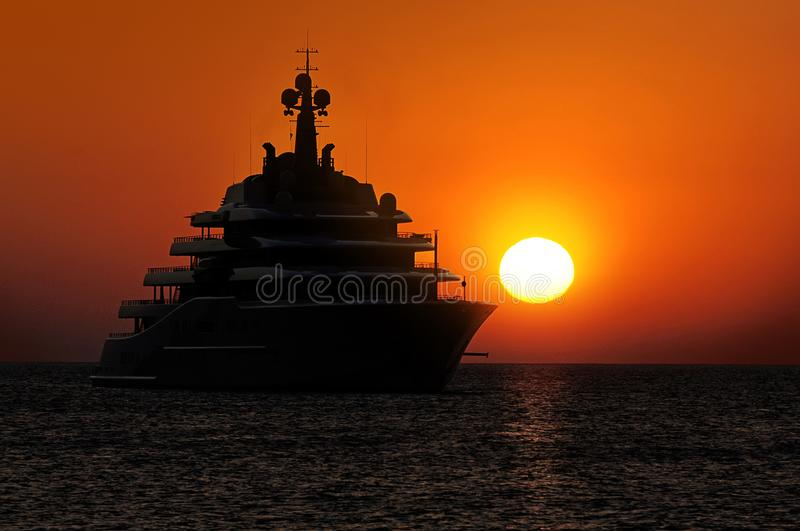 Luxury Superyachts M/Y Eclipse at sunset in Ibiza Spain royalty free stock photography