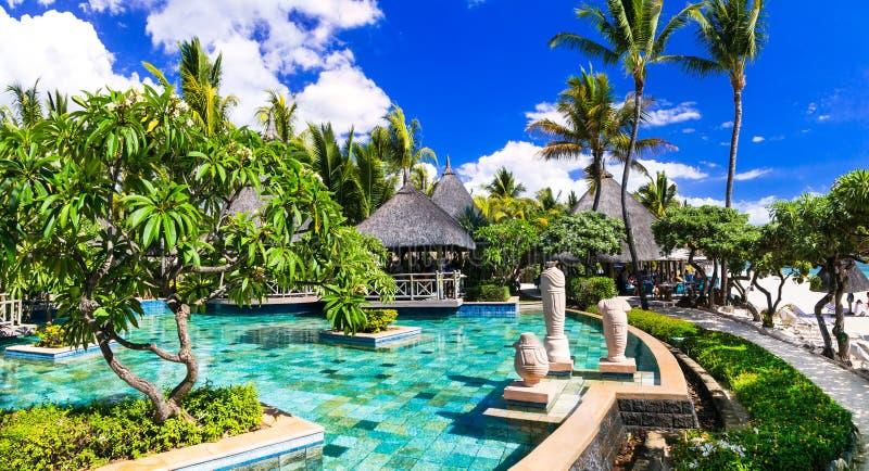 Tropical holidays - swim pool area and bar near the beach. Mauritius island. Luxury swimming pool and bar,Mauritius island royalty free stock photos