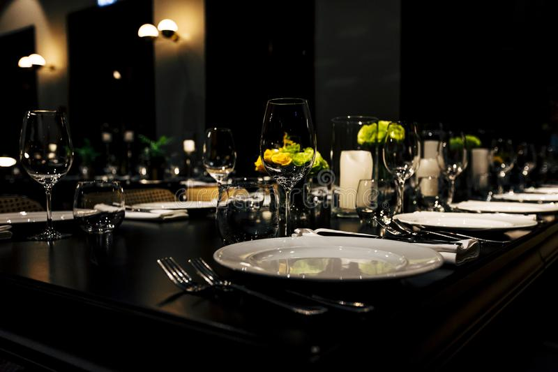 Luxury Table setting for weddings and social events. Luxury table settings for fine dining with and glassware, beautiful blurred background. For events royalty free stock photography
