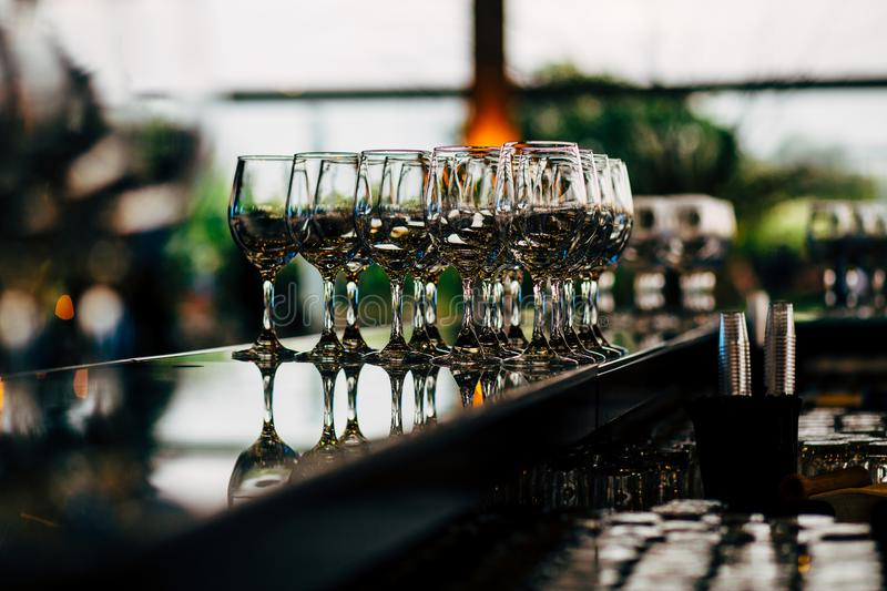 Luxury Table setting for weddings and social events. Luxury table settings for fine dining with and glassware, beautiful blurred background. For events stock images