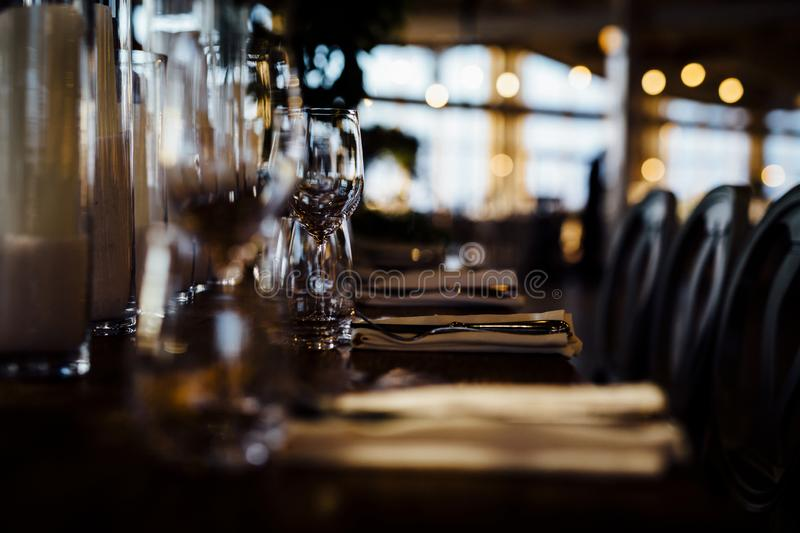 LUXURY TABLE SETTINGS 2019 for fine dining with and glassware, beautiful blurred background. For events, weddings. Preparation f. Luxury table settings for fine stock photos