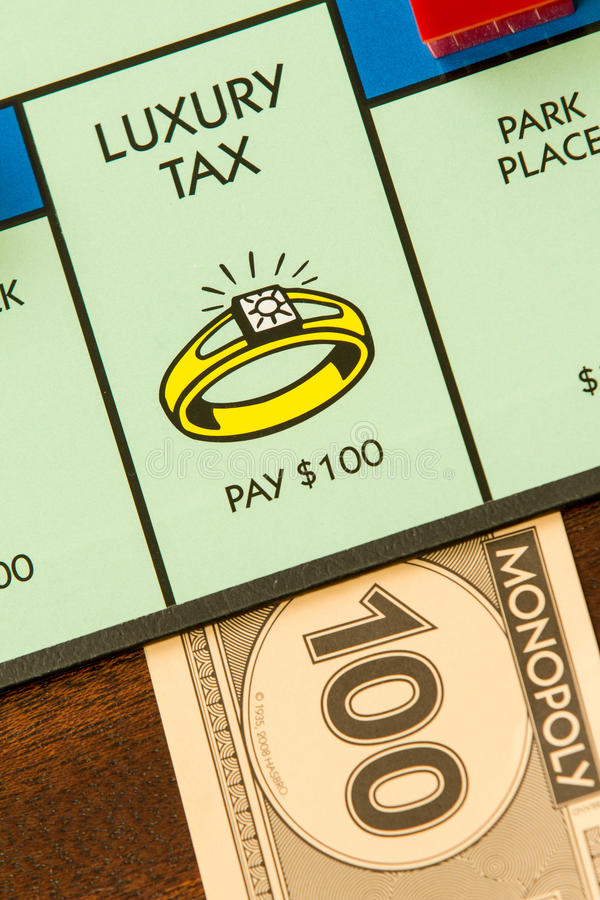 Luxury tax time. BOISE, IDAHO - NOVEMBER 18, 2012: The imposted luxury tax for landing on the wrong spot of the Hasboro game Monopoly stock images