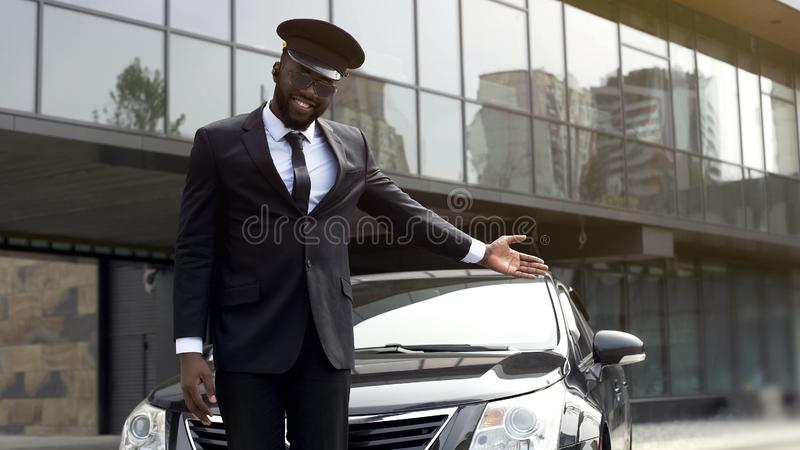 Luxury taxi service driver welcoming very important client near, expensive car. Stock photo stock photography