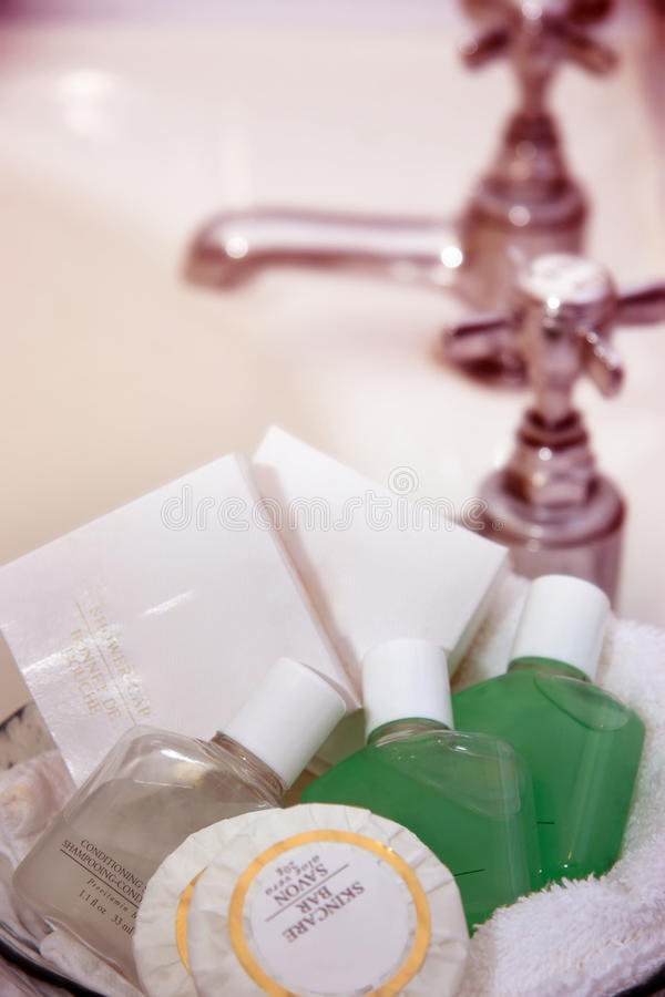 Luxury toiletries. A beautiful mix of toiletries beside a sink stock images
