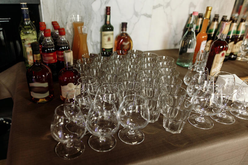 Luxury transparent glasses for whiskey and cognac on stylish dec royalty free stock images