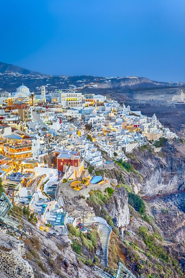 Luxury Travel Destinations and Romantinc Places. Marvelous and Striking View of Thira City in Santorini Island Before the Sunset. At Volcanic Caldera Mountains stock image